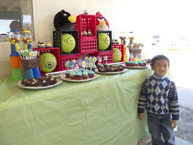 angry birds dessert table and birthday boy