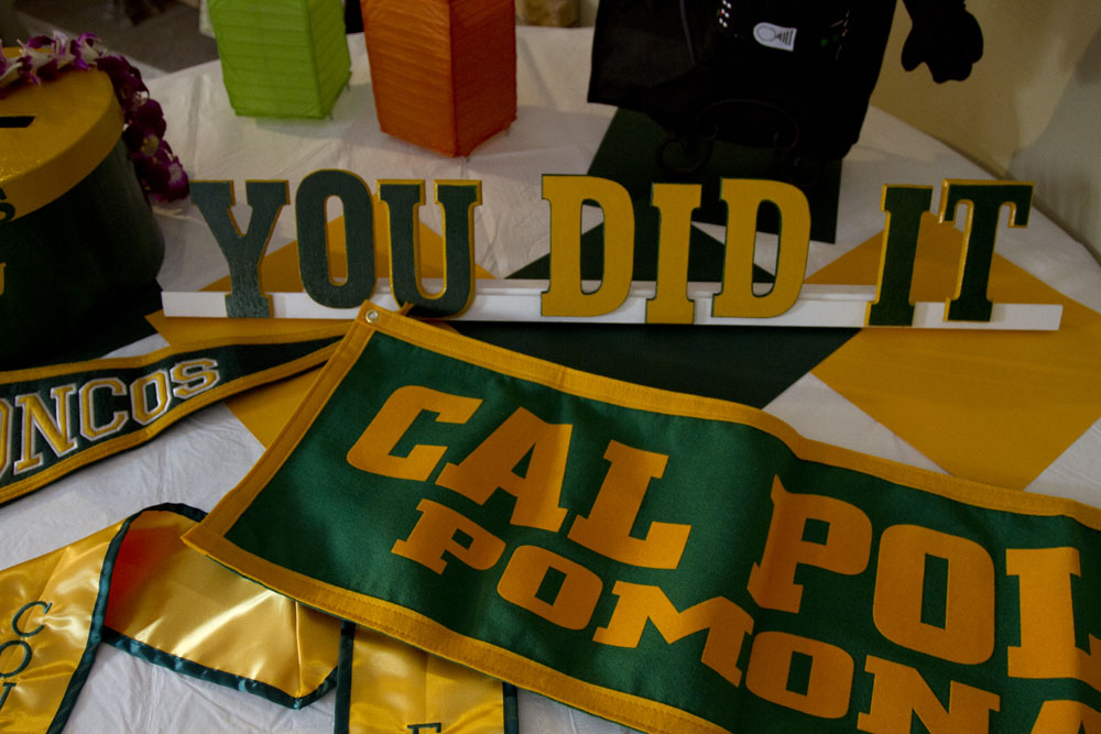 cal poly pomona graduation material with darth vader doll