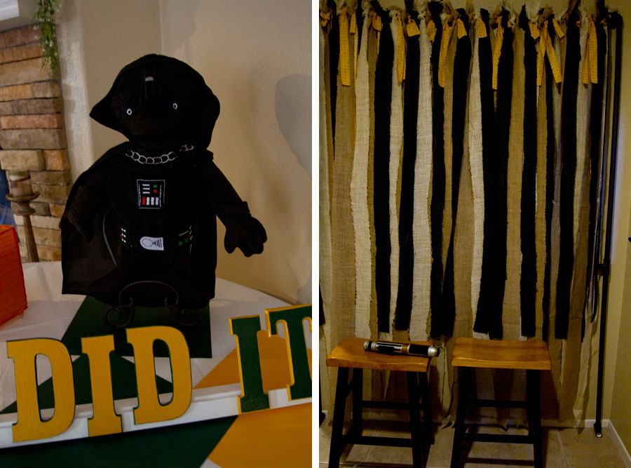 photo booth backdrop and darth vader doll