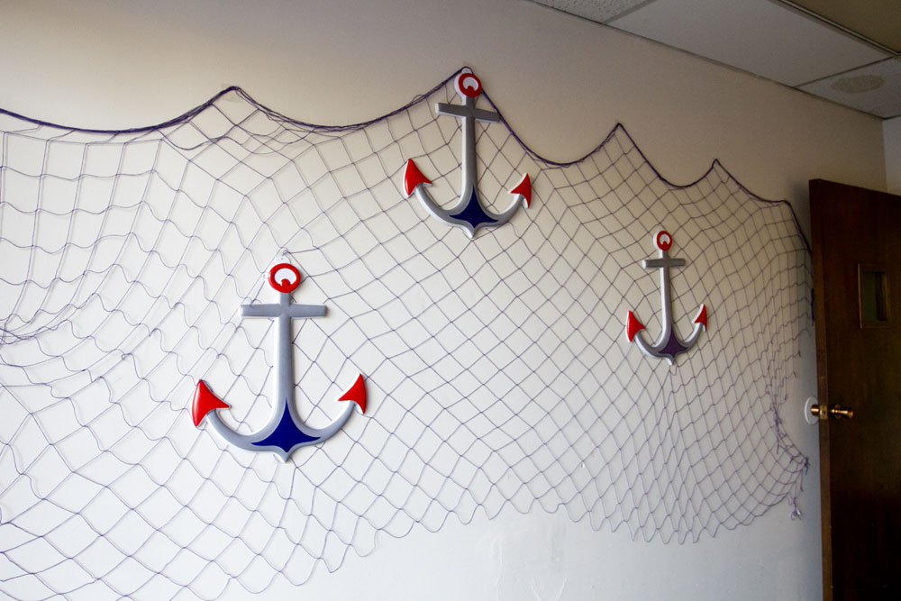 anchors and nets on the wall